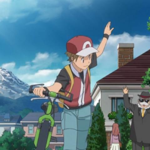 Rojo con su bici despidiéndose del presidente del club de fans Pokémon.