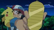 EP795 Ash encontrando una moneda amuleto