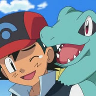 Totodile junto a Ash.