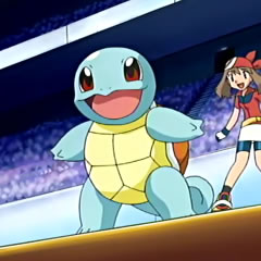 Squirtle junto a May/Aura.