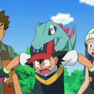 Totodile mordiéndole la cabeza a Ash.