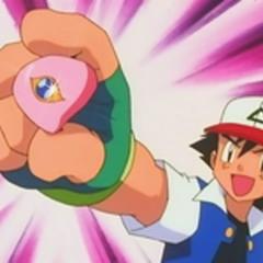 Ash con la medalla Ojo de Coral.