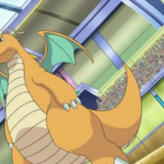 Dragonite junto a Iris.