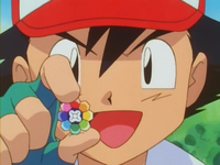 EP026 Ash con la medalla Arcoiris