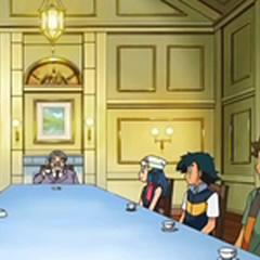 Salón de la mansión. El espacio está repartido mayormente en una larga mesa rectangular.