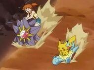 EP033 Misty montada en Starmie y Pikachu en Squirtle de Ash