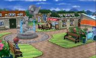 Entrenador sentado en un parque XY
