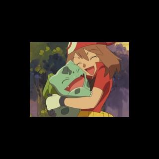 May/Aura abrazando a Bulbasaur.