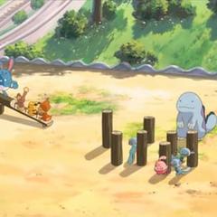 Pokémon jugando en los jardines.
