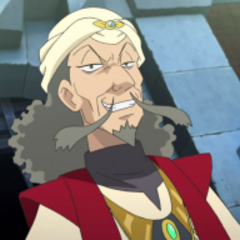 Piedra activadora en el turbante del entrenador de Mega-Alakazam.