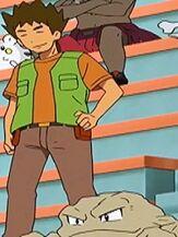 Geodude al lado de Brock viendo la batalla de Misty