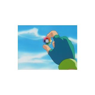 Ash mirando la medalla Arcoíris.