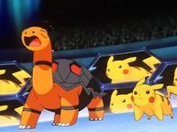 P07 Torkoal y Pikachu de Ash