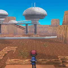 Kalm mirando un edificio en medio de un cañón.