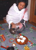 Habesha woman filling coffee cups
