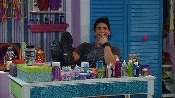 Jax on Em's scrapbooking table