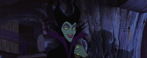 Maleficent grinning evilly