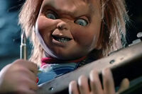 Chucky loud up a gun with real bullet