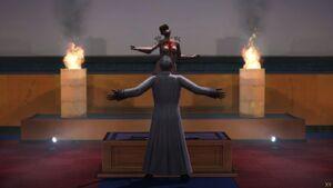 Sean modlący się do manekina pełniącego funkcję bożka