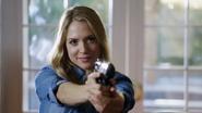 Vanessa Renzy with gun