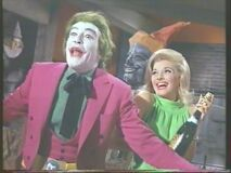 Queenie shares in the Joker's hilarity (Nancy Kovack with Cesar Romero)
