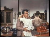 Tina's bullets finish the villainess (Nancy Kovack with Dean Martin)