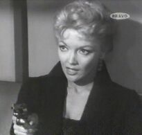 Miss Grey and gun (Mari Blanchard)