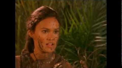 Sydney Fox (Tia Carrere) mud fight followed by a quick shower