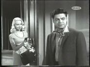 SMIRKING EVELYN COVERS ANDAMO WITH A GUN (JOI LANSING WITH ROSS MARTIN) - Copy