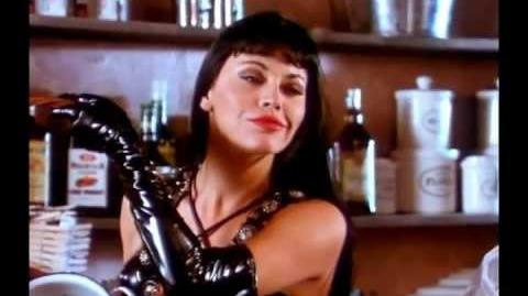 Musetta Vander as Villainess in Leather with whip