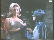 Queenie - glum as Batman snaps on the cuffs (Nancy Kovack with Adam West)