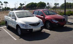 Two Phoenix Motorcars in parking lot