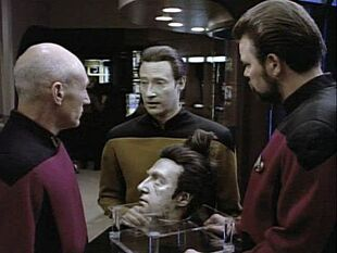 <small>Picard, Data and Riker with Data's severed head</small>|Part 1]]