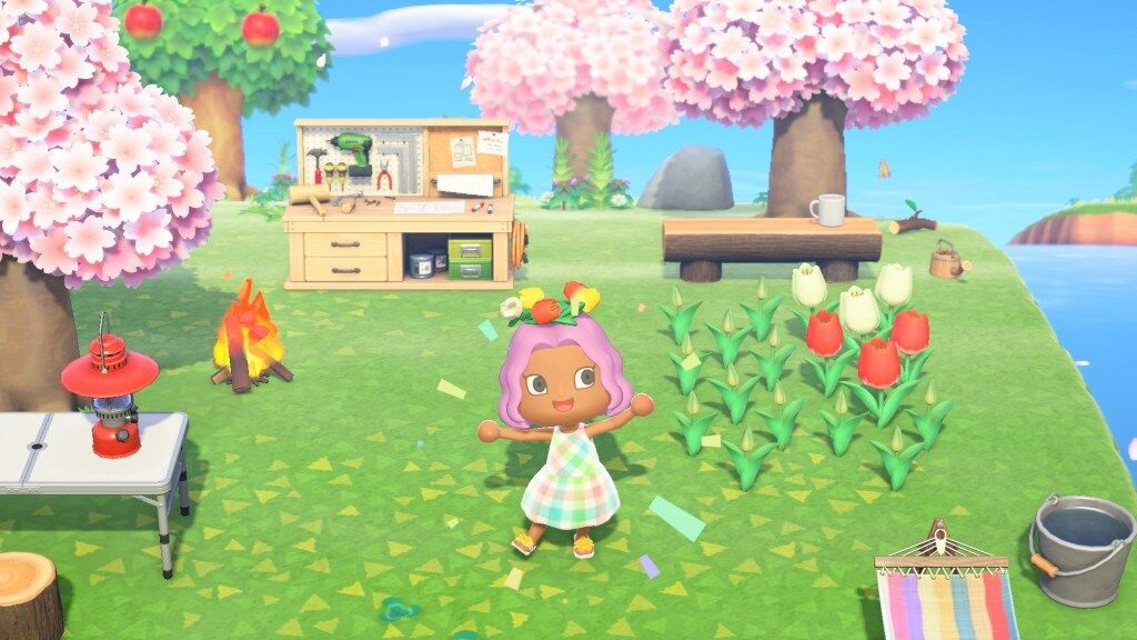 An Animal Crossing Villager excitedly shows off their new flower crown.