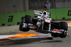 Kamui Kobayashi Airborne While Practicing For The 2011 Singapore Grand Prix