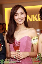 Fala Chen Holding Glass Wine