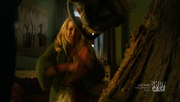 Wikia Fae - Kenzi taking a chainsaw to The Norn's Tree
