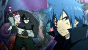 Mistgun observe Natsu, Gajil et Wendy se battre