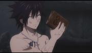 Grey déterminé à détruire E.N.D., alors que Natsu veut rapporter le livre à Ignir