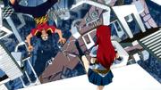 Erza donne un coup de pied à un membre de Twilight Ogre