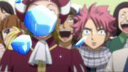 Natsu aperçevant les morceaux de lacrima tombés