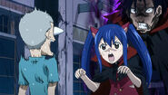 Gajeel helps Wendy scare a kid