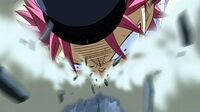 Natsu dragged across the floor