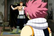 Gildarts shows Natsu the damage