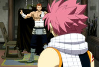 Gildarts shows Natsu the damage