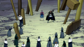 Gildarts and Laki crowded by the wood-dolls