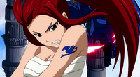 Erza continues attacking