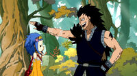 Gajeel patting Levy