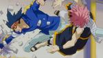 Natsu evades the punch