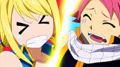 Natsu steps on Lucy while dancing